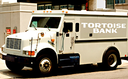 a tortoise bank armored car drives through the city