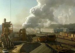 industrial scene with railway and lots of smoke